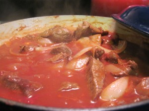 Simmer the meat (or mushrooms) in tomato paste and spices.