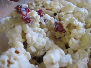 Sticky Popcorn with White Chocolate, Marshmallows, Cashews, and Dried Cranberries