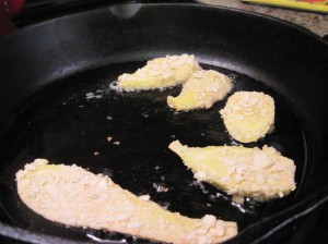 Squash frying in the cast-iron skillet