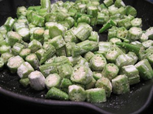 Toss the dredged okra in the oil to coat.