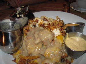 The Pile with Gravy and Cheese Sauce Applied