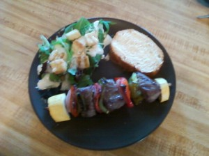 Meat Kebabs and Salad