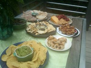 Close-up on the effortless party spread. Guacamole, pastry puffs, hummus, cheese, done.
