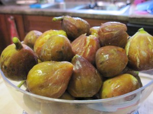 Beautiful fresh figs go on the kitchen scale.