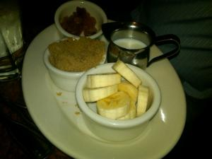 Oatmeal Toppings at Grand Luxe Cafe: Golden Raisins, Brown Sugar, Milk, Bananas