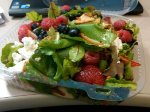 Composed salad from work with berries, nuts, and goat cheese.