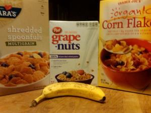 Barbara's Shredded Spoonfuls, Grape Nuts, Trader Joe's Corn Flakes, and a Banana