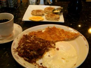 No, really, I'll take one of everything: Swedish pancakes, corned beef hash, hash browns, eggs, and coffee.