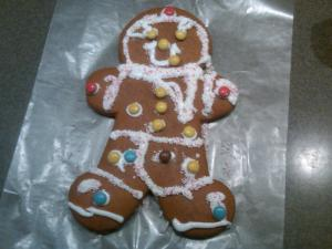 This gingerbread man wears mittens, shoes, and pants.