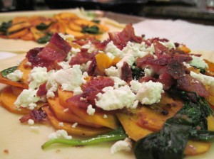 Top the sweet potato mixture with goat cheese and chopped bacon.
