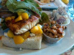 The catch of the day: Blackened Grouper on Foccacia with mango salsa, feta, and greens.