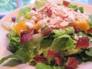 Simple Seasonal Salad with a Moroccan Twist: Romaine lettuce, toasted almonds, mango, goat cheese, and chopped dates (not bacon!)