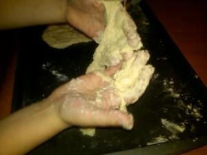Pizza dough hands are fun, and borderline gross. A delcious thrill.