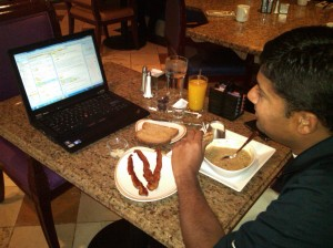 A working breakfast, with all the major food groups and some technology present!