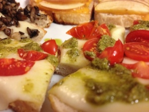 Grape Tomatoes with Mozzarella and Pesto Bruschetta (little pizzas really)