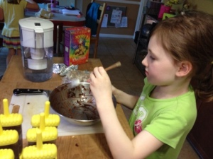 The Eldest Practical Cook Junior at work on her pudding pops.