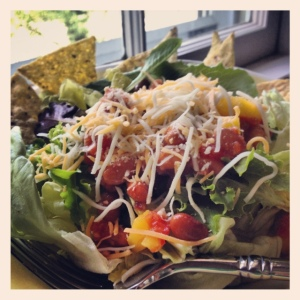 Leftover mango salsa, some beans, a bit of cheese = insta-salad.