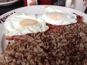 Corned beef hash with eggs over medium, side of kasha from Veselka
