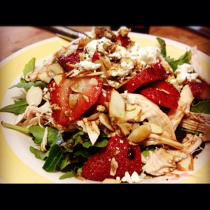 Speedy Salad: Strawberries, rotisserie chicken, almonds, goat cheese, greens.