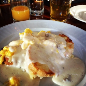 Biscuits with gravy topped by eggs, with juice. And a beer. Because it's Brooklyn Star!