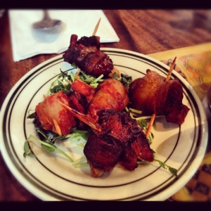 Bacon-wrapped almond-stuffed dates at Olea in Fort Greene. Worth the trip.