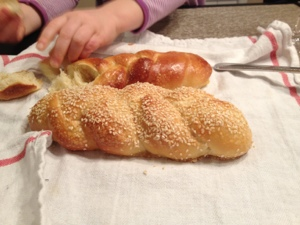Small hands reaching for the Challah.