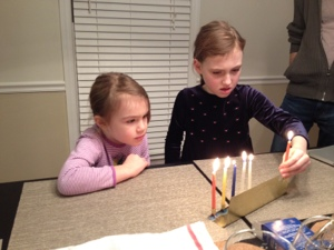 TPCs Junior learn how to light the candles.