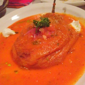 Chile relleno: a stuffed poblano that was lightly battered, fried, smothered and covered.