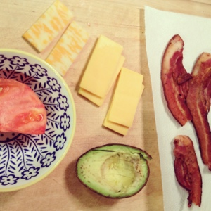 Veggie burger toppings: bacon, avocado, cheese