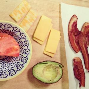 Veggie burger toppings: bacon, avocado, cheese