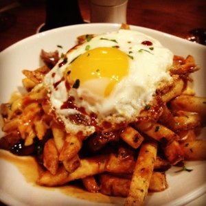 The Poutine topped with an egg from Public House. When time has no meaning, combine breakfast, lunch, and dinner.