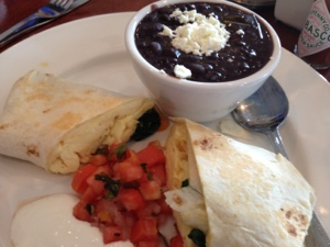 It is possible to eat healthy here: breakfast burrito with black beans and spinach from Canal Street Bistro.