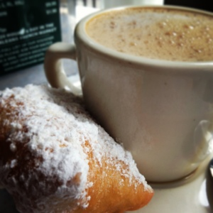 Cafe au lait and beignets from Cafe Du Monde: iconic for a reason.
