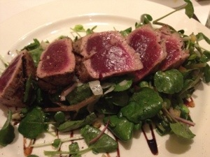 Rare tuna on a bed of greens. Perfect light entree.