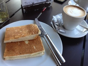 Ham and cheese with a side of cafe con leche from Tapa Tapa in Barcelona.