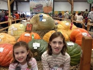 Until next year, leaving the largess of pumpkin behind. TPCs Jr celebrate the overlarge veggies at N.C. State Fair!